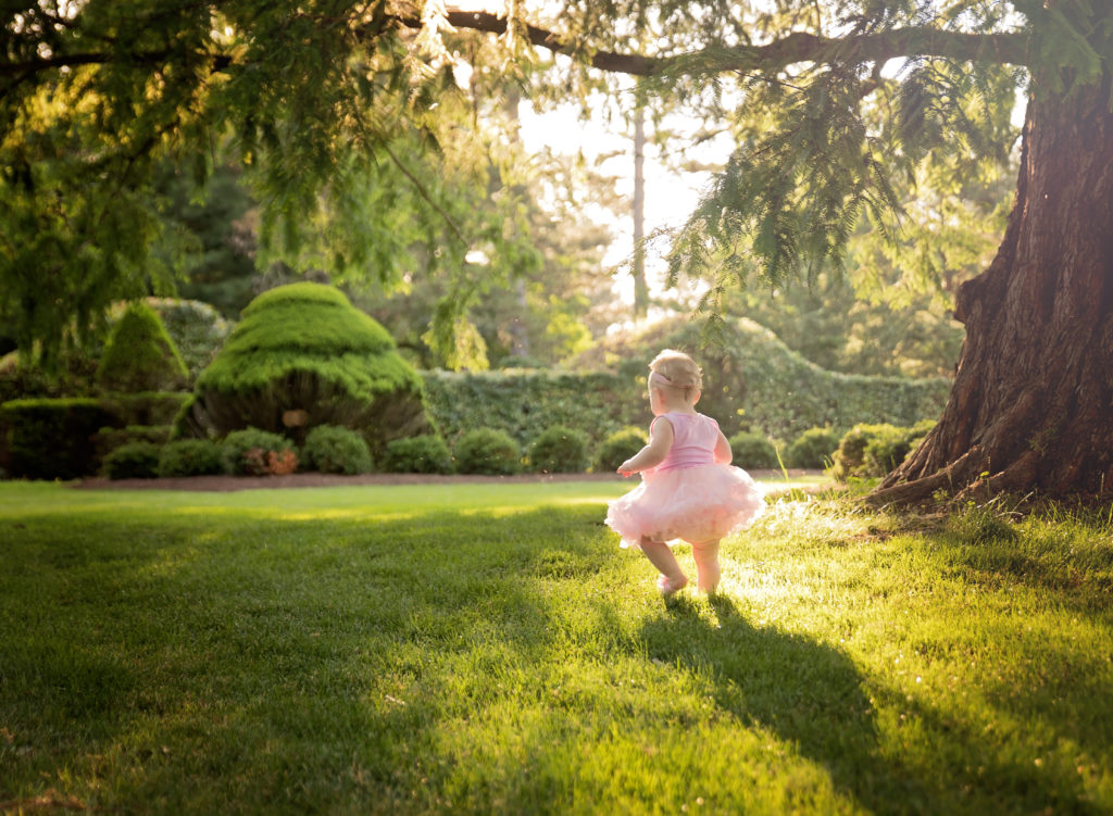 kathy rogers photography, lorain county photographer, newborn photographer, senior photographer, family photographer, maternity photographer, child photographer, little girl, milestone, birthday, first, one, pink, tutu, sunlight, trees, woods, park, outdoors, running