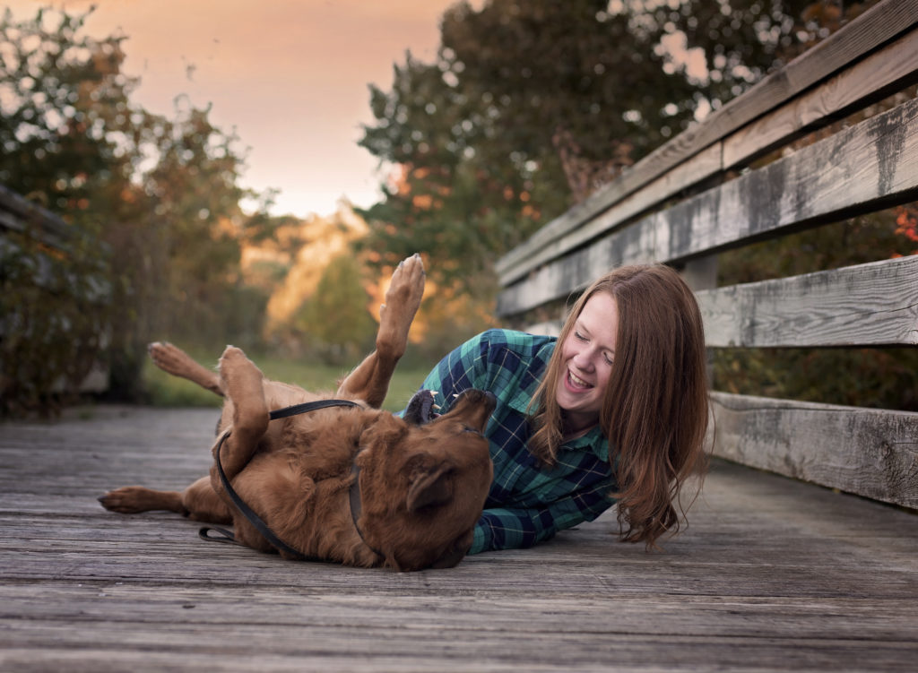 kathy rogers photography, lorain county photographer, newborn photographer, maternity photographer, family photographer, child photographer, senior photographer, photos, pictures, photography, senior, girl, playing, dog, bridge, outdoors, plaid, woods, trees, sunset