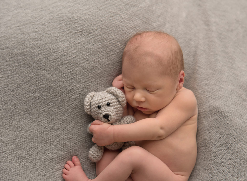 kathy rogers photography, lorain county photographer, newborn photographer, senior photographer, family photographer, maternity photographer, child photographer, photos, photography, pictures, sleeping, baby boy, newborn, studio, holding, bear, knitted