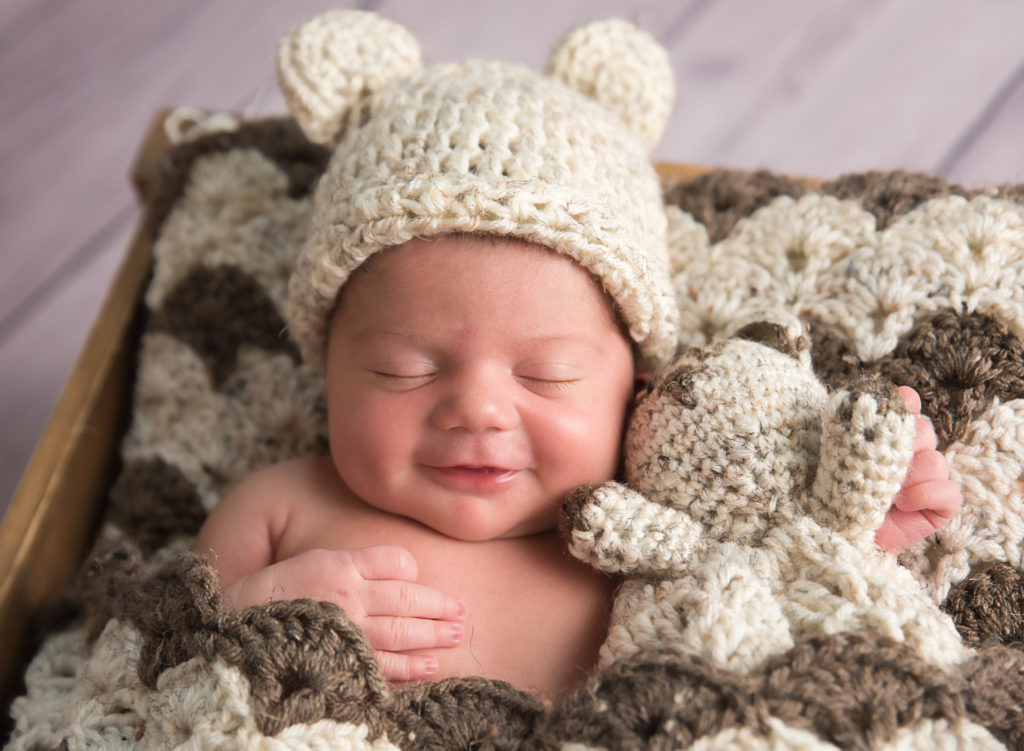 kathy rogers photography, lorain county photographer, newborn photographer, senior photographer, family photographer, maternity photographer, child photographer, photos, photography, pictures, smiling, knit, hat, ears, bear, crate, newborn, baby boy