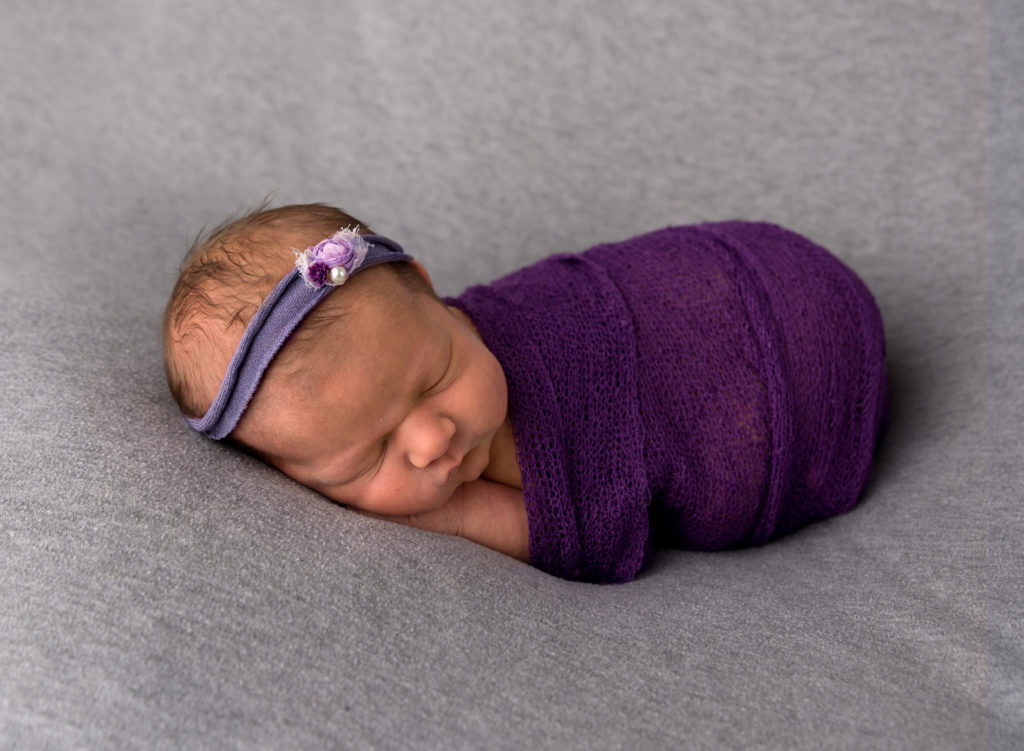 kathy rogers photography, lorain county photographer, newborn photographer, senior photographer, family photographer, maternity photographer, child photographer, photos, photography, pictures, baby girl, newborn, headband, wrap, purple, flower, studio, sleeping