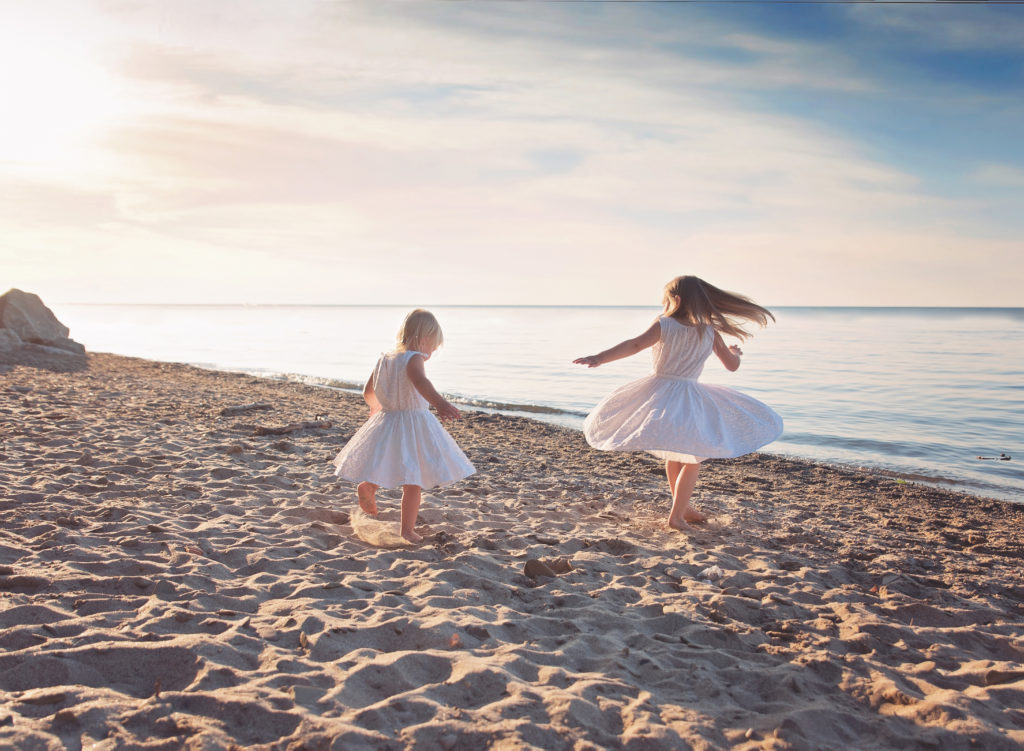 kathy rogers photography, lorain county photographer, newborn photographer, senior photographer, family photographer, maternity photographer, child photographer, beach, little girls, twirling, lake, sand, sisters, clouds