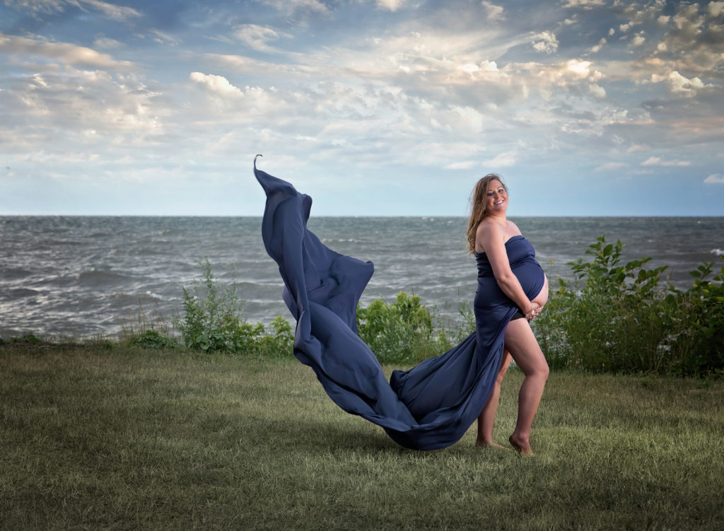 kathy rogers photography, lorain county photographer, newborn photographer, senior photographer, family photographer, maternity photographer, child photographer, photos, photography, pictures, pregnant, maternity, lake, water, beach, park, blue, dress, clouds, baby belly