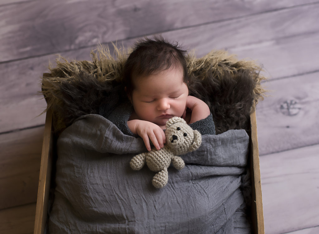 kathy rogers photography, lorain county photographer, newborn photographer, senior photographer, family photographer, maternity photographer, child photographer, baby boy, sleeping, crate, studio, bear, knitted, fur