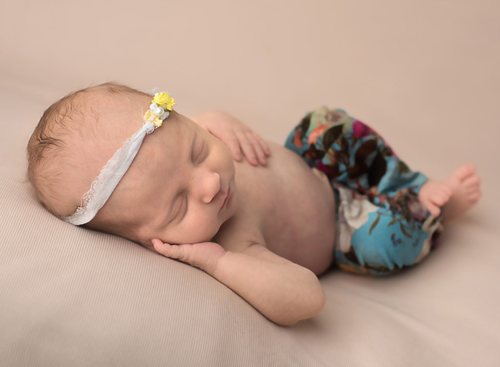 newborn photography_newborn photographer_baby girl_ baby photos_floral pants_sleeping newborn