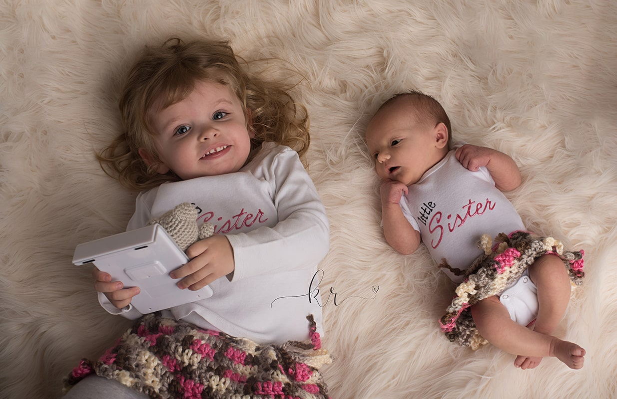 kathy rogers photography, lorain county photographer, newborn photographer, maternity photographer, family photographer, child photographer, senior photographer, photos, pictures, photography, newborn, baby girl, sleeping, pink, baby sister, big sister, crochet, skirt, matching, cream, fur, blanket