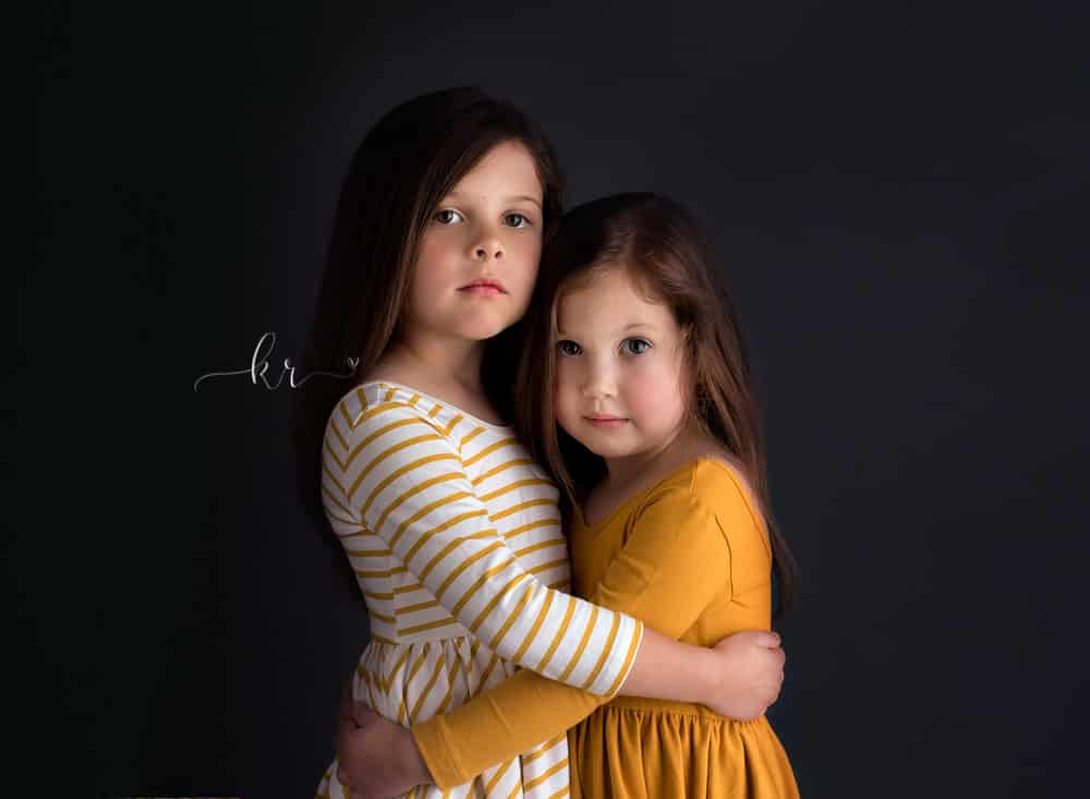 kathy rogers photography, lorain county photographer, newborn photographer, maternity photographer, family photographer, child photographer, senior photographer, photos, pictures, photography, girls, studio, sisters, mustard, dresses, pin stripe, hug, family, children
