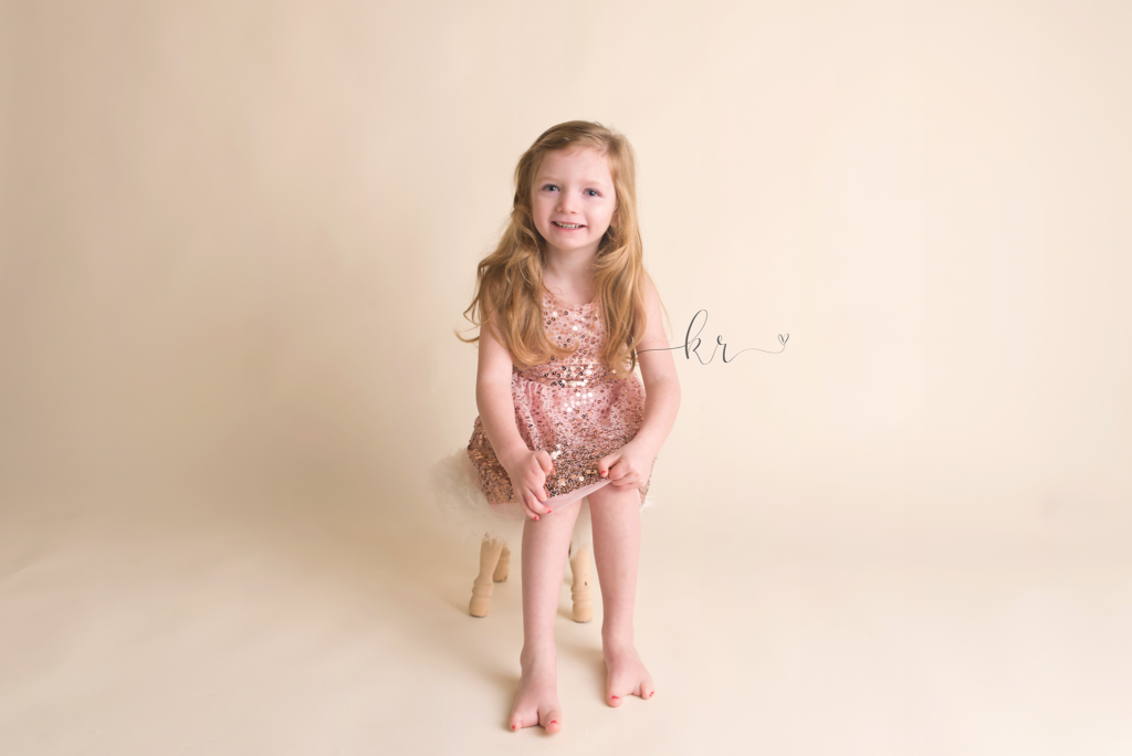 Kathy Rogers Photography_Beautifully Different_Childrens Photographer in Amherst_Little girl pink dress_01