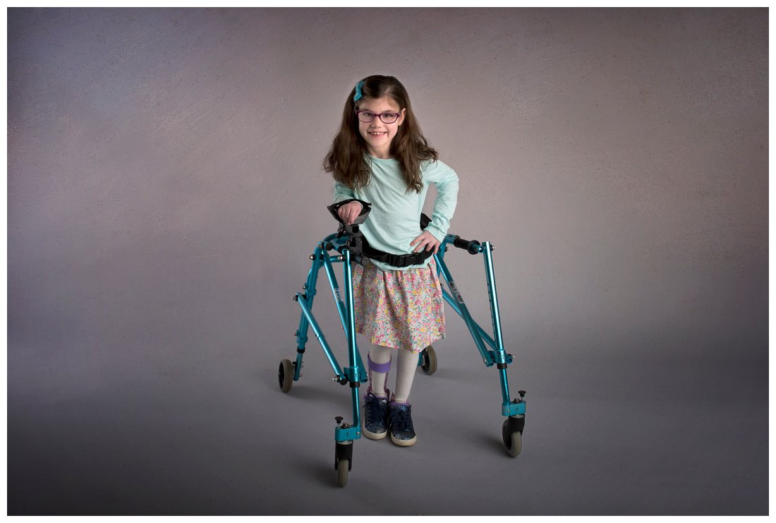 Kathy Rogers Photography_Beautifully Different_Children Photographer in Amherst_Little girl floral skirt_walker